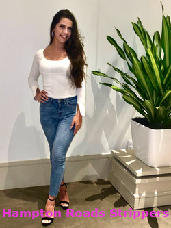 pretty brunette in jeans and white top